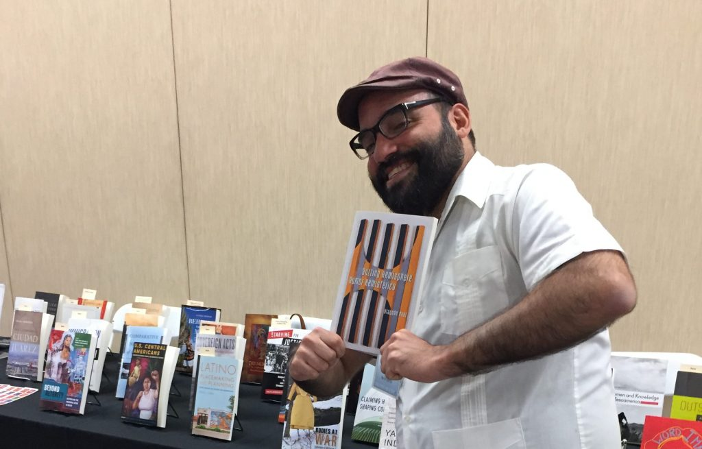 "f99bb54360c Urayoán Noel showing off his poetry collection ""Buzzing Hemispheres"""