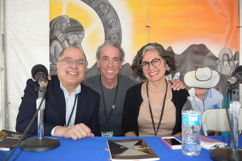 Representing Camino del Sol at the festival, authors Daniel Olivas, Frederick Aldama, and Vickie Vértiz take a moment to pose for photographers on the Pima County Libraries Nuestra Raices stage.