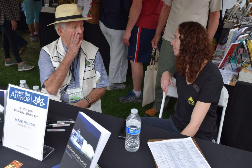 Mark Nelson, one of the eight-person crew for the first two-year closure experiment in Biosphere 2, teases UA Press publicity manager Rose Brandt at his booth signing Saturday afternoon.