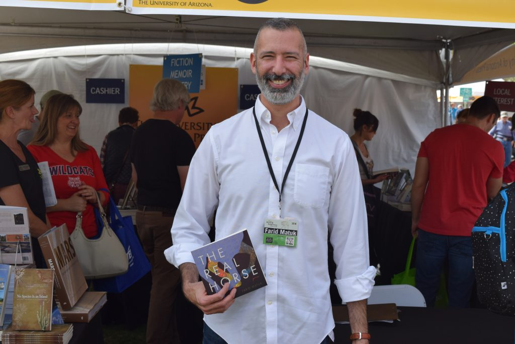 After returning to Tucson following this year's AWP conference in Florida, poet Farid Matuk took the time to sign copies of his latest collection The Real Horse at the UA Press booth.